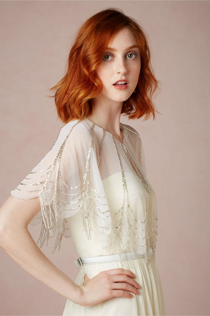Lines of shining beads course down over soft ivory tulle, where they drip past a hem embellished with scallop upon glimmering scallop.  Trickling Capelet - BHLDN.com $140