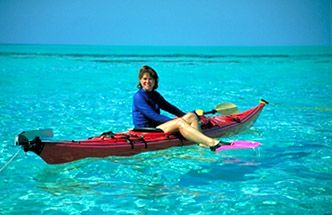 Sea kayaking over eagle rays, and dropping a mushroom anchor to snorkel off your kayak in aquarium-like water!