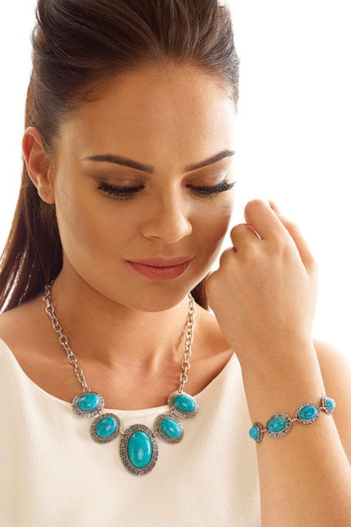 Turquoise & Silver Coloured Bracelet  £8.00 Beautifully crafted oval turquoise stones set in patterned silver coloured cases. Bracelet has a T-bar fastening. L22cm x W1.6cm