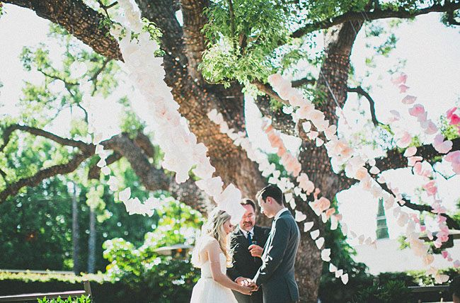 Lower Lawn Ceremony Idea! Pink ombre hanging garland for ceremony backdrop