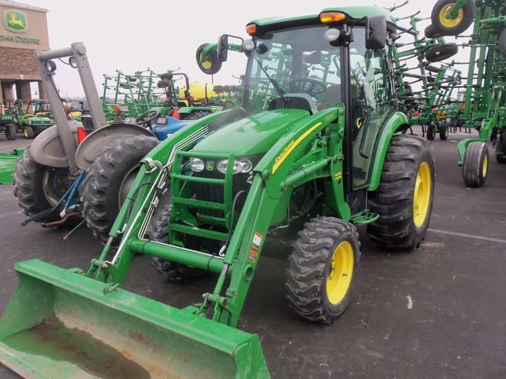 John Deere  4720 cab tractor equipped with  400CX loader