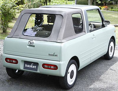 Japanese microcar in the Kei class. Very small and for urban use only. This one is made by Daihatsu, a division of Toyota.