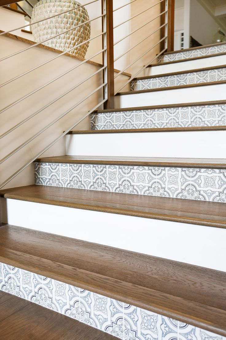 Alternating tile on stair risers with wood treads.  Really nice effect.