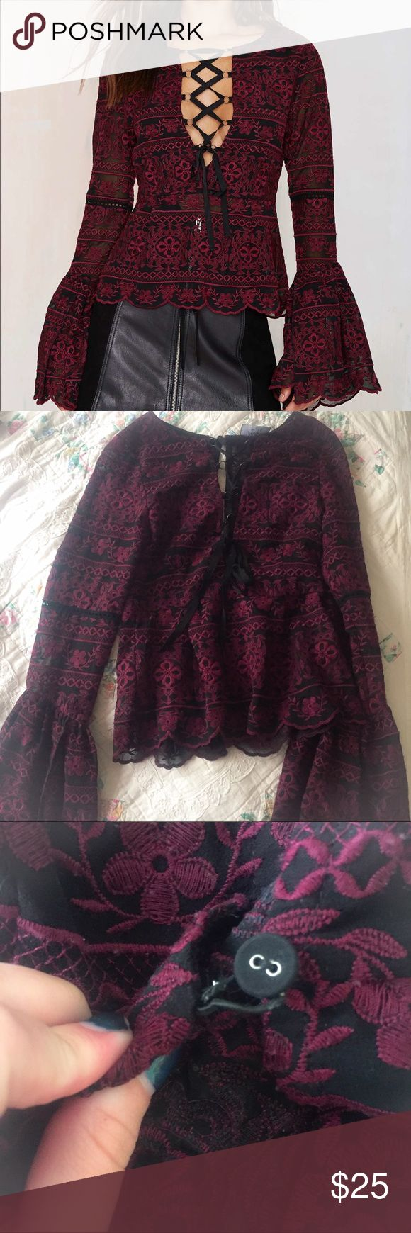 Nasty gal love her madly lace up top Nasty gal love her madly lace up bell sleeve top. Super cute and sexy. Worn 3-4 times. One of the back button closures is a little bit loose but it doesn't effect wear. Fits true to size.  ✖️NO HOLDS OR TRADES(no exceptions)✖️ No lowest?/lowballing-$3 offers, or offering half price will be immediately declined AND BLOCKED from my closet 💲10% discount on bundles-everything must go! 💖NO NEGOTIATING IN THE COMMENTS! Nasty Gal Tops Blouses