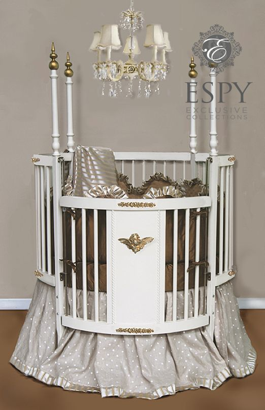 Dreaming Round Crib bedding. colors graham cracker, pewter, linen.  gender neutral bedding for round crib.bumpers are scalloped with ruffle tops. Matelasse inside, silk outside. Linen skirt with embroidered dots. includes matching comforter