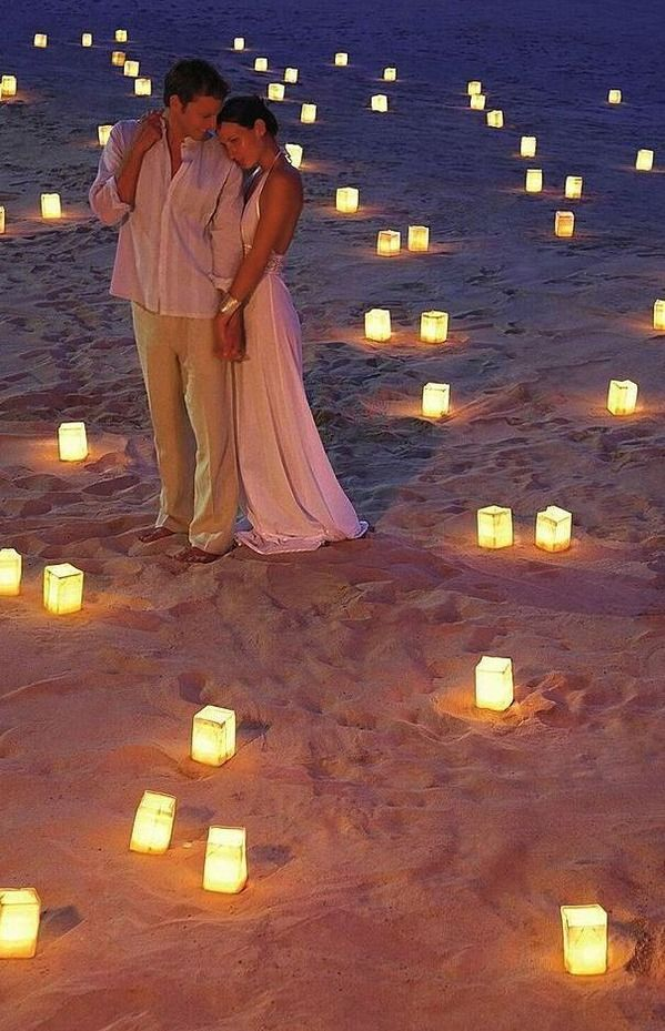Beach Wedding Decor - Candle lights in the sand add ambience, especially after sunset, & make for romantic photos.