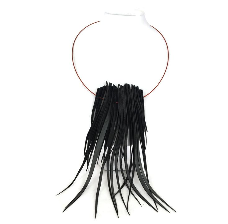Long spiky upcycled inner tube necklace by Laura Zabo