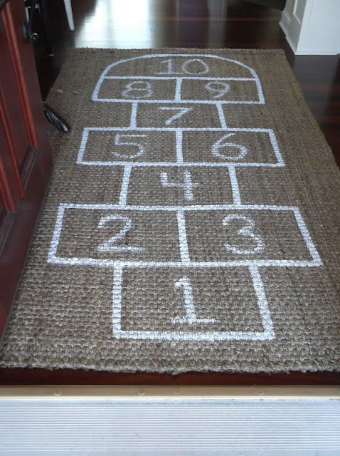 Use a jute rug to make a hopscotch mat!!  Love this for the kiddos' gameroom!  Would be perfect for indoor fun on a rainy day!