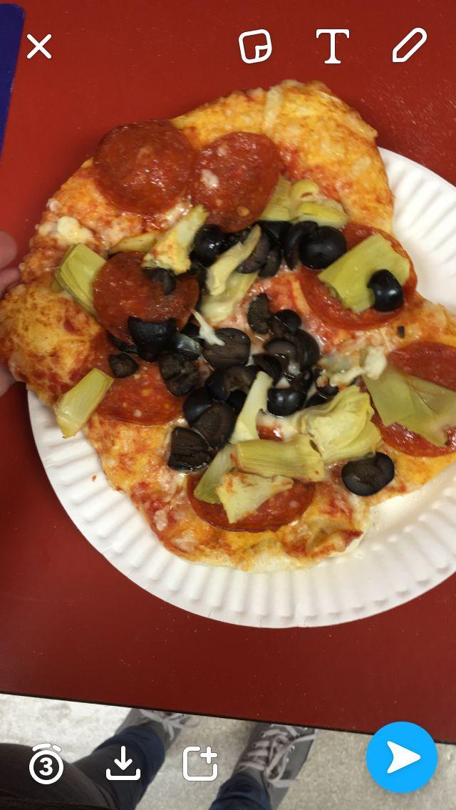 Pizza ..tomato sauce, Olives, artichokes,and pepperoni..    Oven temperature 515 degrees..