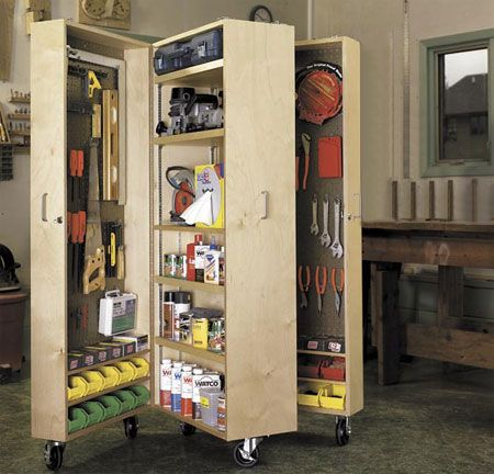 "Workshop Storage Unit  22½"" wide (outside 6"" ea. & center section 0"") X 6' high X 21½"" deep.  Made out of 3/4"" plywood for main body & upright divider and ½"" plywood for back & shelves. Shelves & back edges are dado-ed Back edges are rabbited. ¼"" pegboard applied inside cabinet are mounted on small wooden blocks to allow room for the pegboard hooks to mount. Piano hinges connect the cabinets together. Used heavy duty casters. Made by Richard H. http://www.hometalk.com/137368/"