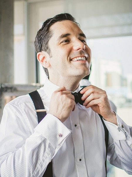 We love a happy groom! Such a great shot by Ten·2·Ten Photography.