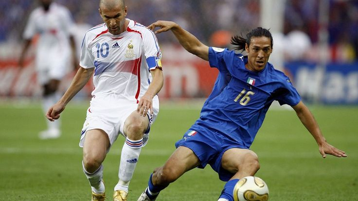 BERLIN - JULY 09: Zinedine Zidane of France pressurises Mauro Camoranesi of Italy during the FIFA World Cup Germany 2006 Final match between Italy and France at the Olympic Stadium on July 9, 2006 in Berlin, Germany. (Photo by Shaun Botterill/Getty Images)
