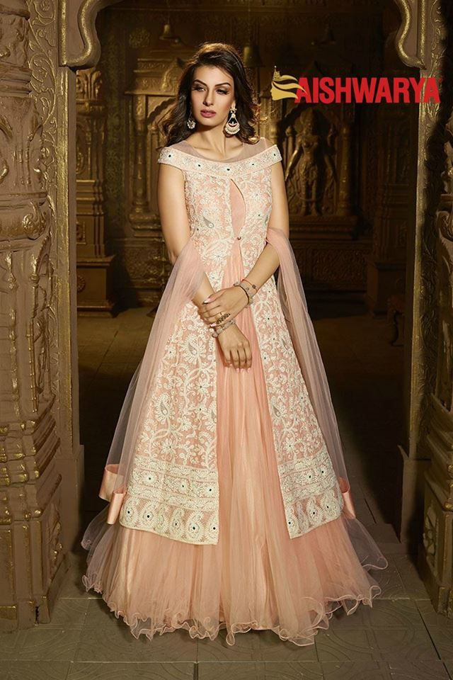 All it takes is something as classy as this dress to create a magical look! Buy Suit online - http://www.aishwaryadesignstudio.com/exotic-peach-designer-suit-with-jacket