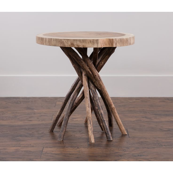 This nature-inspired round side table is a one-of-a-kind accent that's sure to attract attention. Made by Liberte, this table allows you to bring an outdoor aesthetic into your living room or bedroom. It is 22 inches high, wide, and deep.