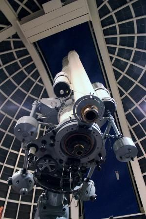 Telescope, 12-inch aperture refracting telescope and observatory class tracking astronomical mount, all by Carl Zeiss of Germany. This is the principal public telescope at Griffith Observatory, Los Angeles. Mounted on the main telescope is a 9-inch aperture Zeiss refracting telescope.