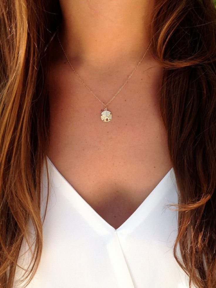 Sand dollar necklace. Perfect for summer <3 N & K Designs