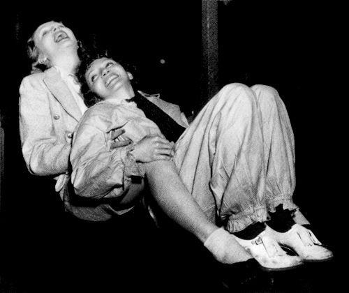 The first ever paparazzi photograph taken of two high profile Hollywood actresses who were having an affair with each other. Marlene Dietrich and Claudette Colbert sliding down a chute in a Venice Beach amusement park.