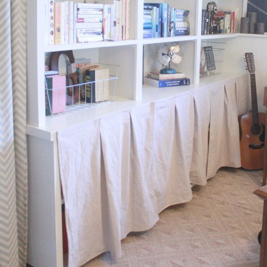 A simple solution to hide toy clutter using a drop cloth and industrial strength velcro.