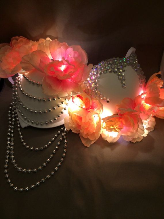 EDC Alive Bra  $85.00  Elegant rave bra featuring glittering pink light up flowers, silver drop down beads, and iridescent rhinestones that is perfect for EDC  royalraves.com