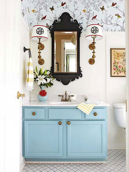 With a coat of soft blue paint and new hardware the bathroom instantly feels brighter.
