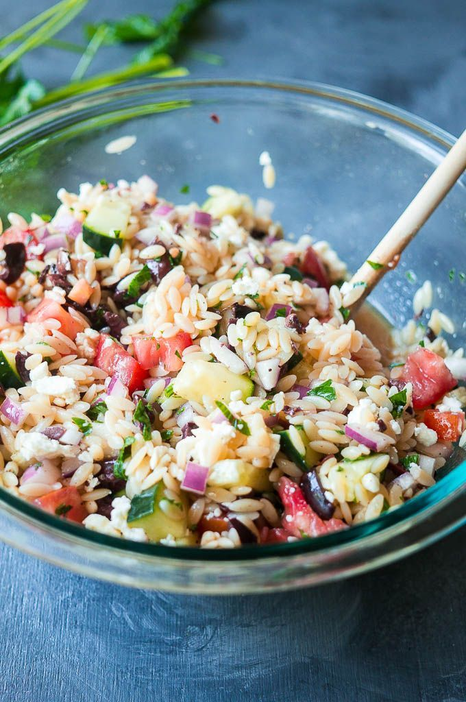 Jump into spring with this fresh Greek flavored take on a traditional pasta salad!