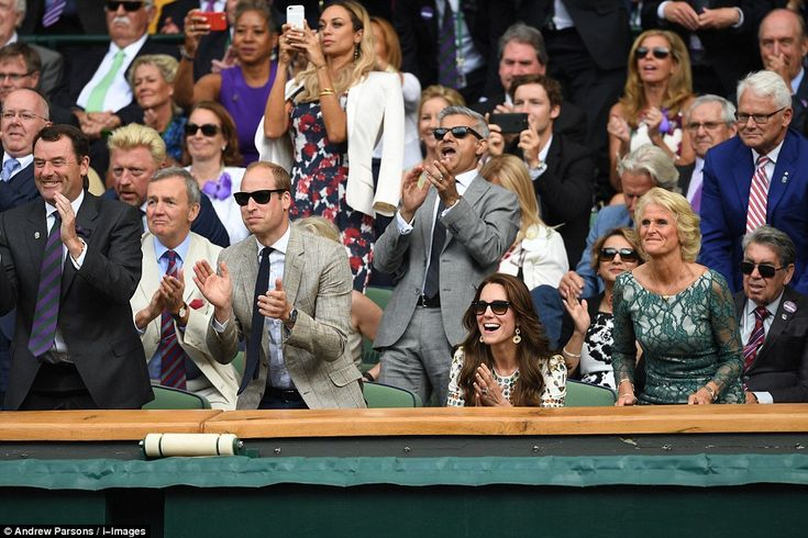 William leapt to his feet in the Royal Box, while Kate looks equally as excited by the action unfolding on court