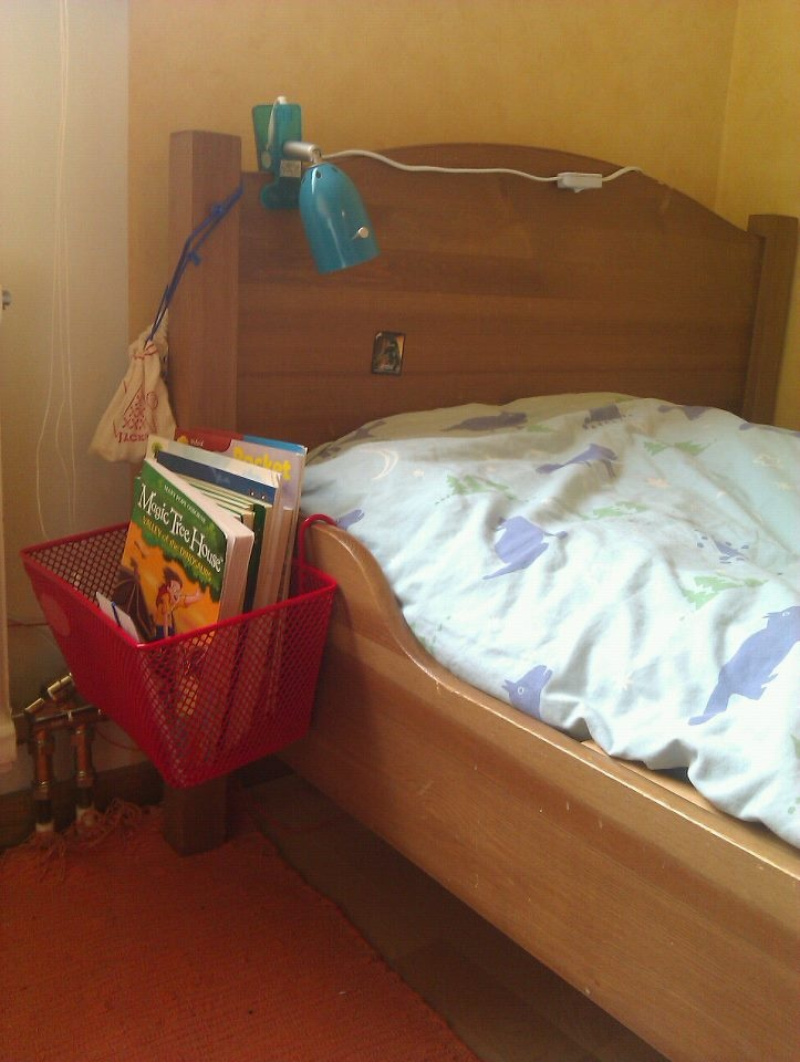 A kid's bike basket turns into a neat little bedside library for our sons who love reading before going to sleep.