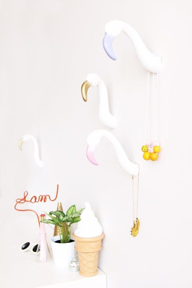 Add some flamingo head hooks to your wall.   25 DIY Projects That Will Fill You With Joy