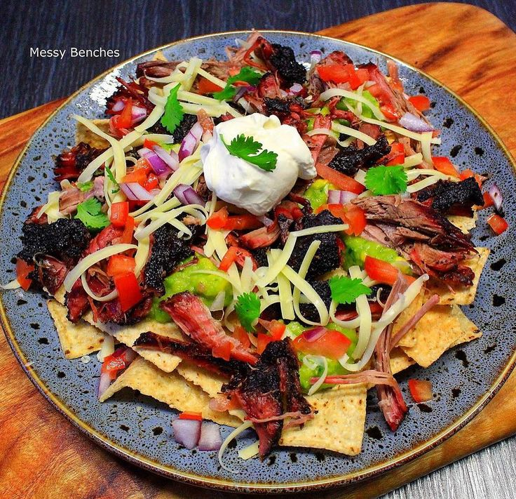 Pulled Beef Nachos. Chuck dressed in smokeyq Coffee Rub and smoked over cherrywood, tortilla strips, guacamole, pico de gallo, cheese and sour cream 😋