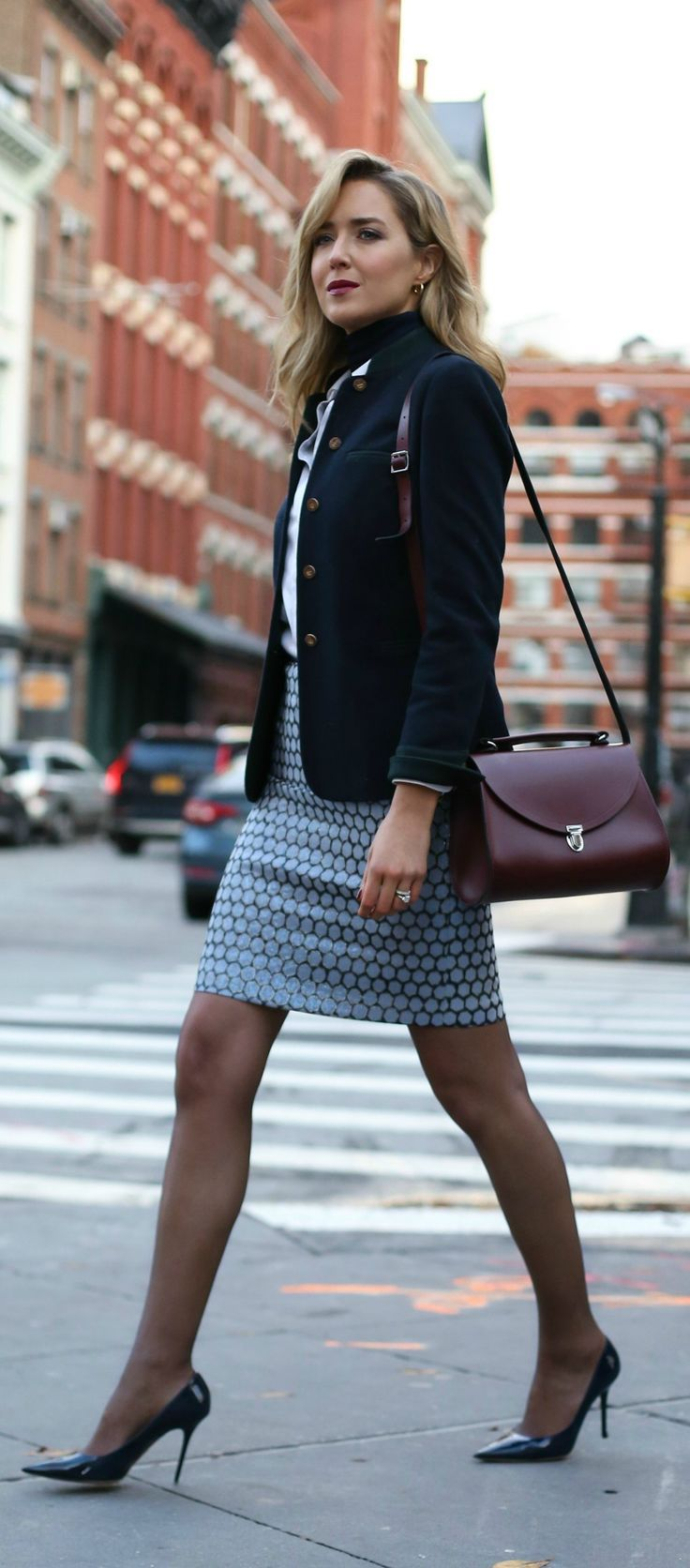 metallic jacquard blue, navy and gold pencil skirt, classic navy blazer, layered navy turtleneck under white button down shirt, sheer navy tights, patent pointy toe pumps, burgundy satchel bag