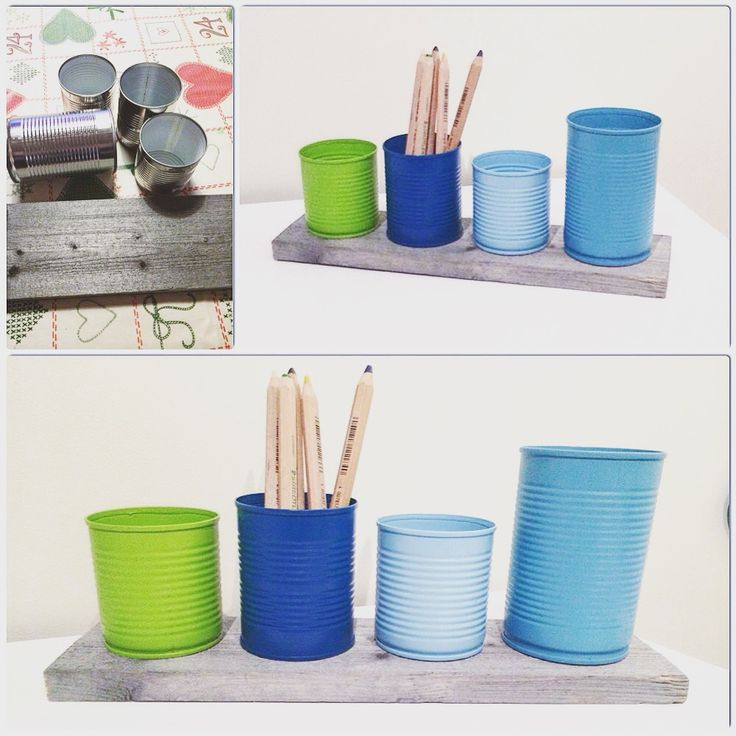 Spraypainted tin cans, glued them on a woodenboard.