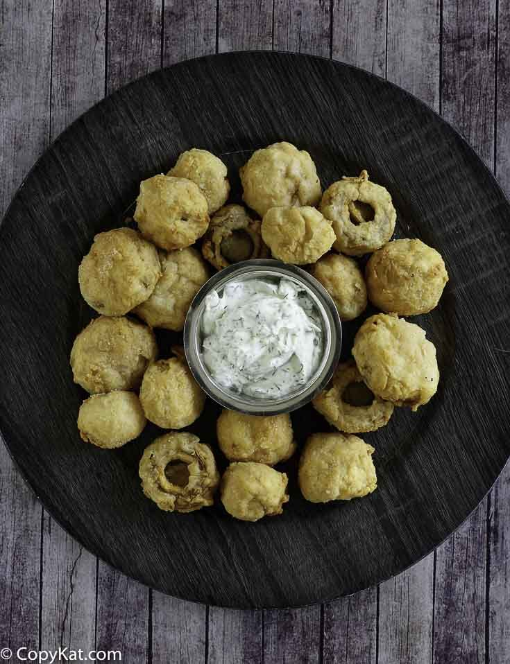 You can make your own homemade copycat Logan's Roadhouse Fried Mushrooms. These are so easy to make, and you can enjoy them without leaving home.