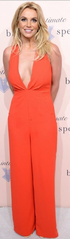 Orange jumpsuit, shoes, and jewelry