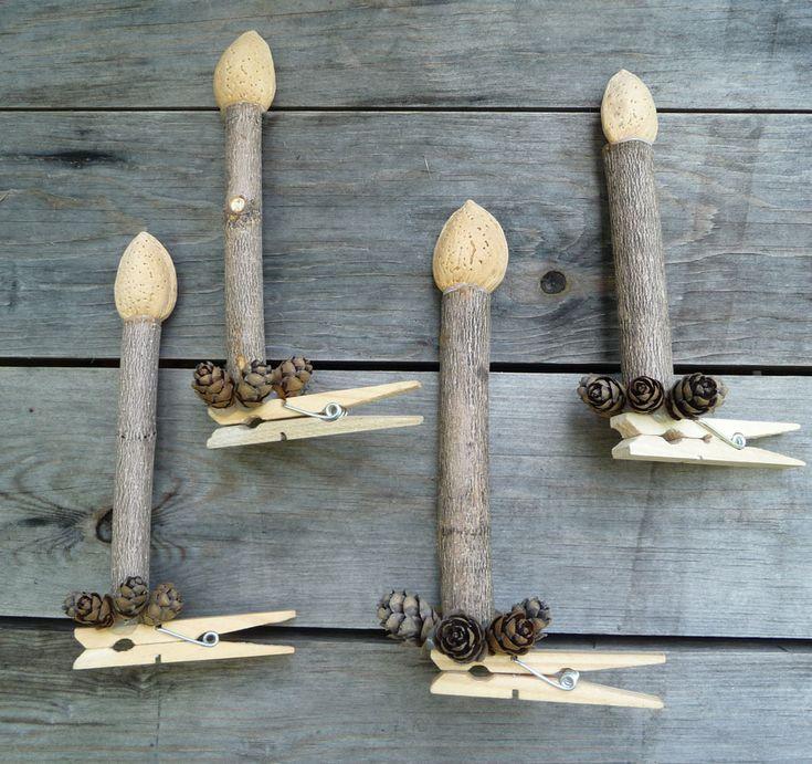 décoration de Noël, bougie ou chandelle avec des amandes entières des pommes de pin et petits morceaux de bois,