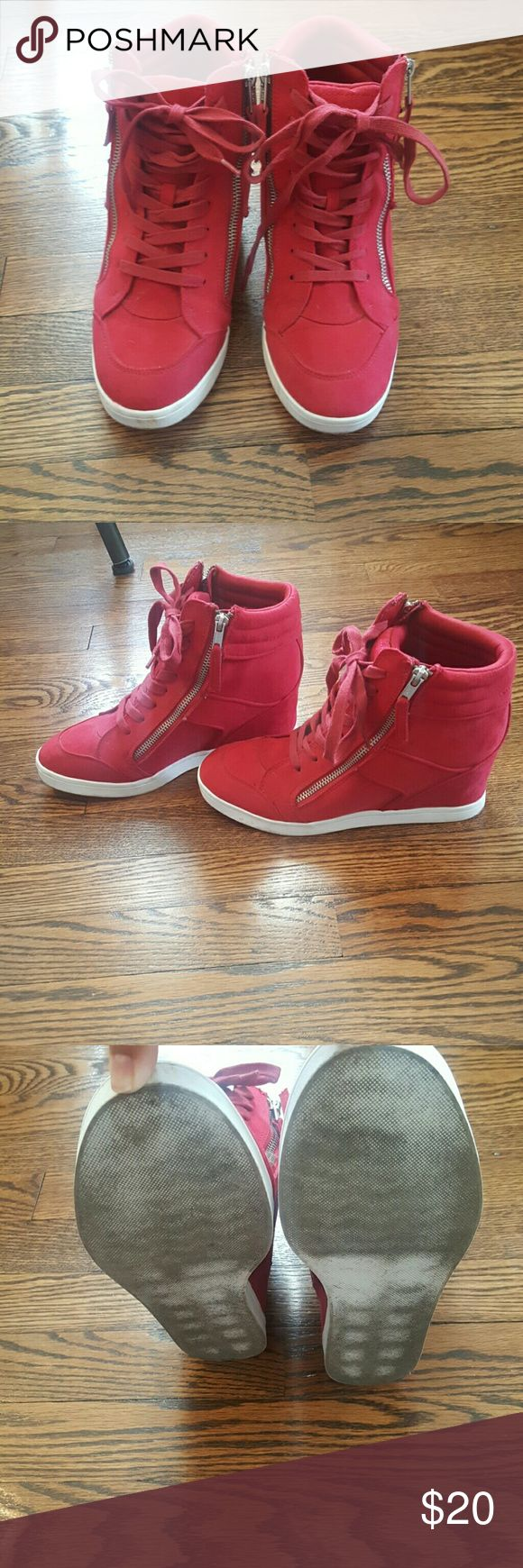Red wedge sneaker These are comfy and stylish. Worn a hand full of times. Have a few scuffs but that can be buffed out. Shoes Wedges