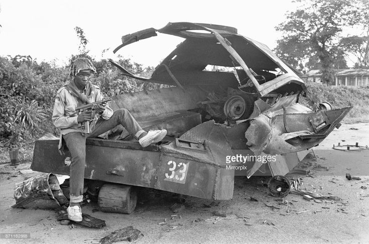 A Biafran soldier seen here sitting on a destroyed Nigerian army armoured personnel carrier, 11th June 1968 . (Photo by Ron Burton/Mirrorpix/Getty Images)