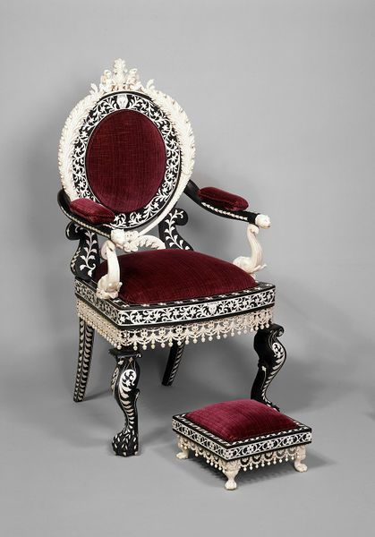 1855 Indian Armchair, These pieces are based on models made in 1825-1850 in the Rococo Revival style. The chairs and matching footstools were made in Berhampur, India.