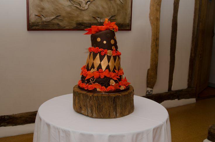 Fantastic three tier wonky chocolate, orange and gold wedding cake