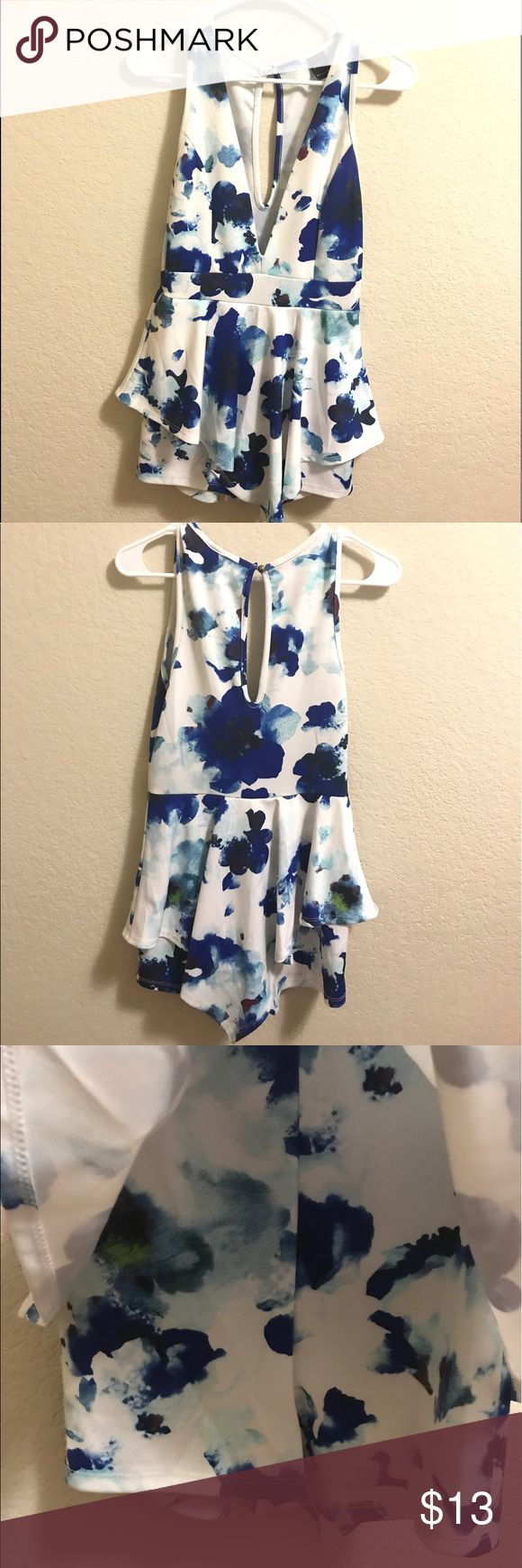 "Blue and white polyester romper Super cute for going out, is a romper with shorts but the front and back have a ""skirt"" on it making it look like a dress/romper together! Other"