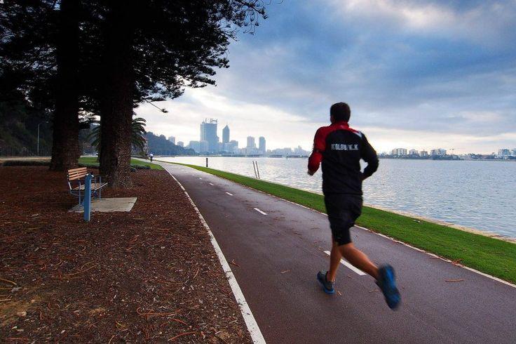 Jogging along Swan River in Perth