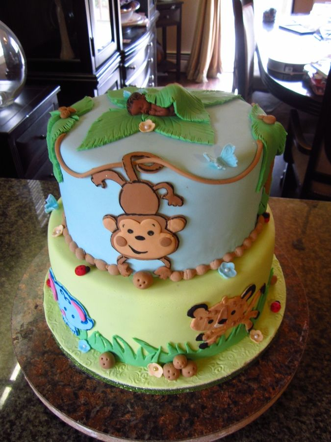 Baby shower cake inspired by the Fisher Price jungle animal theme.