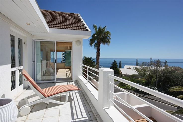 Atlantic Pearl - This magnificent villa, with wraparound views of the sea and mountain, is the perfect family getaway, offering generous interiors with four bedrooms and four bathrooms and an open-plan living style that ... #weekendgetaways #campsbay #southafrica