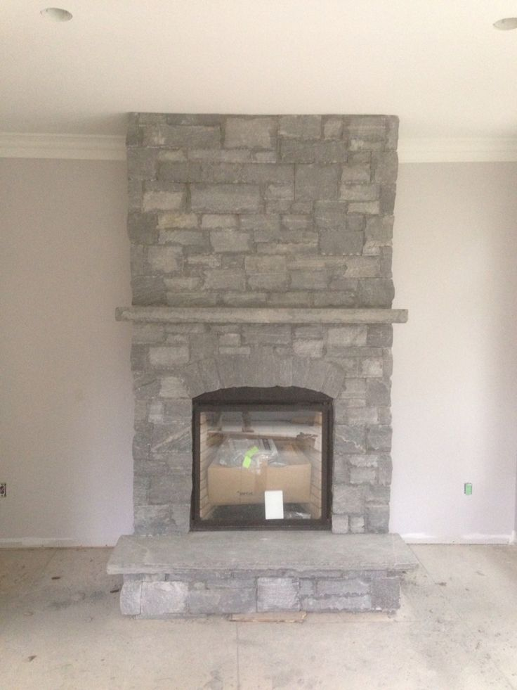 Muskoka granite ledge rock Dry stacked. Complete with stone hearth and mantel.  Done by  Saunders Stone Design