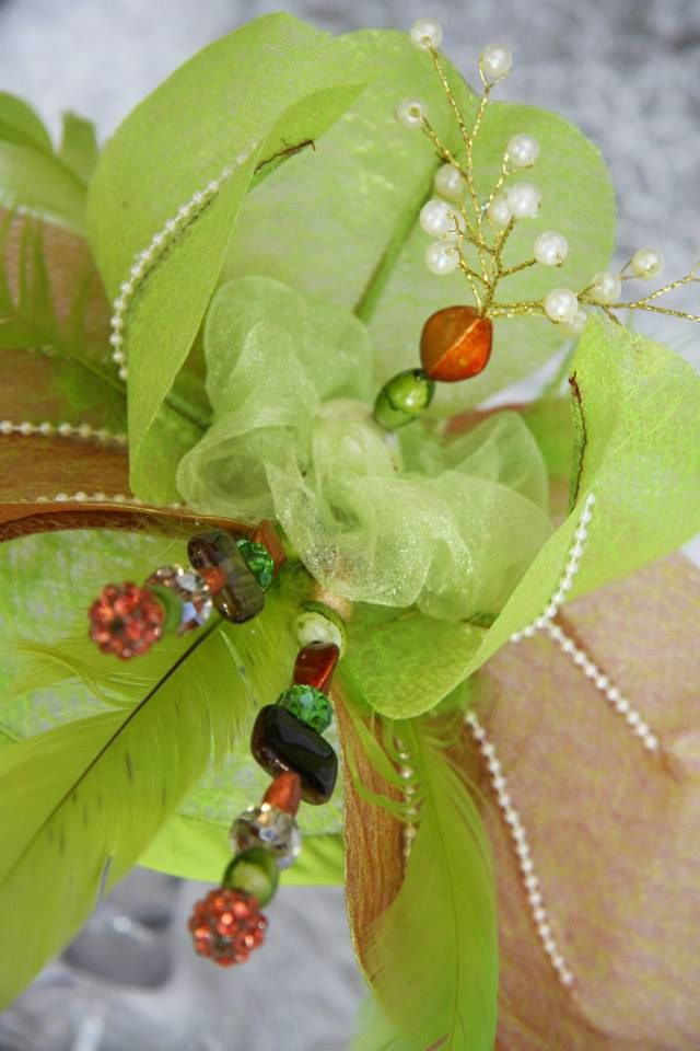 Intricate glass beading immersed inside petals organza