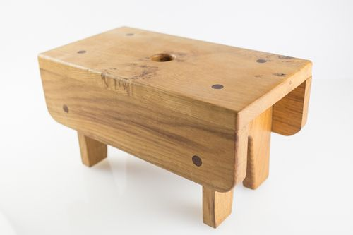 "Oak ""Creepie"" kids stool  Oak 'Creepie' kids stool with wee creepie design detail.  Dimensions: Length: 33cm  Width: 18cm  Height: 18cm  Materials: Oak"