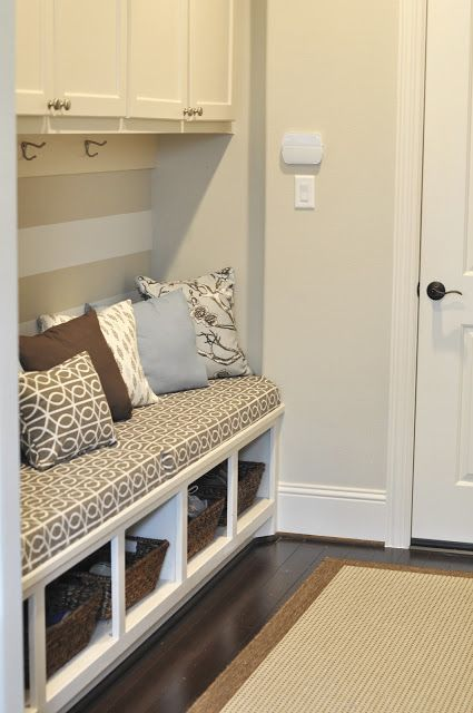 Mudroom Idea. Bench to sit on with pillows and take shoes off. Shoes can go into the little baskets underneath.