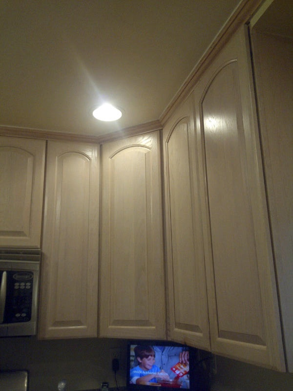 kitchen cabinets before I painted them Pickled Oak a