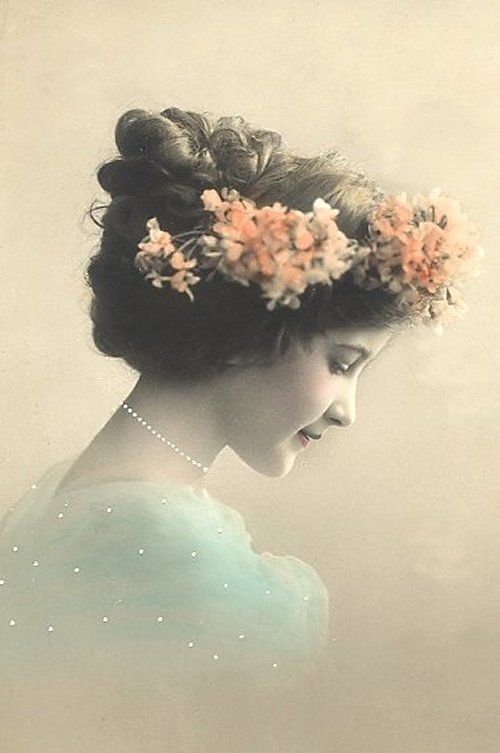 Vintage woman with flowers in hair Free Images