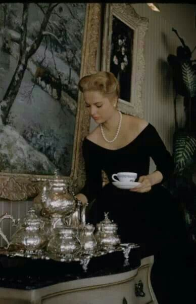 Tea-time with superb actress Martha Hyer (1924-2014) - the epitôme of impeccable, refined beauty - at her elegant Hollywood home in 1959, her silver tea service well-positioned beneath her extraordinary, priceless Píssárro.