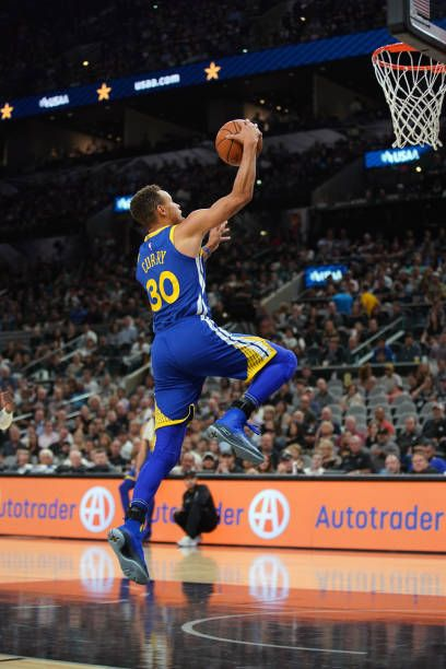 Stephen Curry Of The Golden State Warriors Goes To The Basket